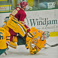 19 February 2016: University of Vermont Catamount Goaltender Packy Munson, a Freshman from Hugo, MN, is thrown down by Boston College Eagle Forward Colin White, a Freshman from Hanover, MA, who subsequently received a penalty for goaltender interference in the third period at Gutterson Fieldhouse in Burlington, Vermont. The Eagles defeated the Catamounts 3-1 in the first game of their weekend series. Mandatory Credit: Ed Wolfstein Photo *** RAW (NEF) Image File Available ***