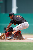 GCL Orioles first baseman Juan Montes (9) receives a pick off throw and blocks Brandon Howlett (5) off the base during a game against the GCL Red Sox on August 9, 2018 at JetBlue Park in Fort Myers, Florida.  GCL Red Sox defeated GCL Orioles 10-4.  (Mike Janes/Four Seam Images)