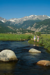 Girlfriends share a nature experience along the Big Thompson River on a clear, blue-sky summer morning at Moraine Park in Rocky Mountain National Park, Colorado (MR#85)