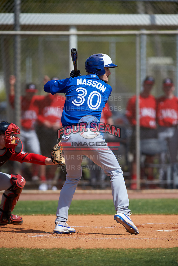 Toronto Blue Jays Jean-Christophe Masson (30) bats during an exhibition game against the Canada Junior National Team on March 8, 2020 at Baseball City in St. Petersburg, Florida.  (Mike Janes/Four Seam Images)