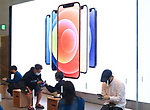 October 23, 2020, Tokyo, Japan - Customer purchase the new 5G iPhone, iPhone 12 and iPhone 12 Pro at an Apple store in Tokyo on Friday, October 23, 2020. iPhone 12 and iPhone 12 Pro started to sell here while iPhone 12 Pro Max and iPhone 12 mini will go on sale next month.        (Photo by Yoshio Tsunoda/AFLO)