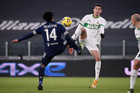 Weston McKennie of Juventus FC and Mert Muldur of US Sassuolo compete for the ball during the Serie A football match between Juventus FC and US Sassuolo Calcio at Allianz stadium in Torino (Italy), January 10th, 2021. Photo Federico Tardito / Insidefoto