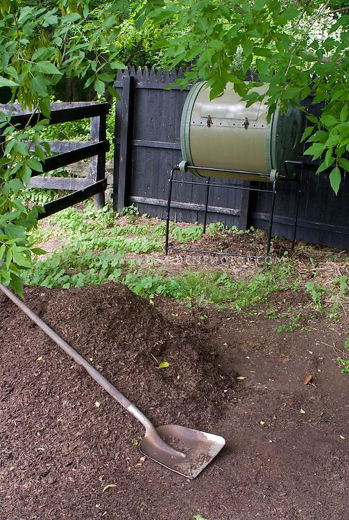 Compost bin rolling type, soil, shovel, digging, finished compost for organic gardening soil amendments