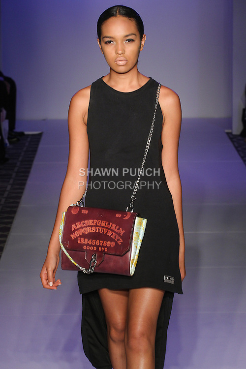 Model walks runway with a handbag from the O Faolain Spring Summer collection by Bryant Phelan, for the Designer's Collective fashion show, at Fashion Gallery NYFW Spring Summer 2016 show, during New York Fashion Week.