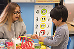 Education Preschool classroom scenes 3-4 year olds SEIT working with boy in classroom