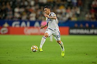 CARSON, CA - SEPTEMBER 15: Cristian Pavon #10 of the Los Angeles Galaxy moves with the ball during a game between Sporting Kansas City and Los Angeles Galaxy at Dignity Health Sports Park on September 15, 2019 in Carson, California.