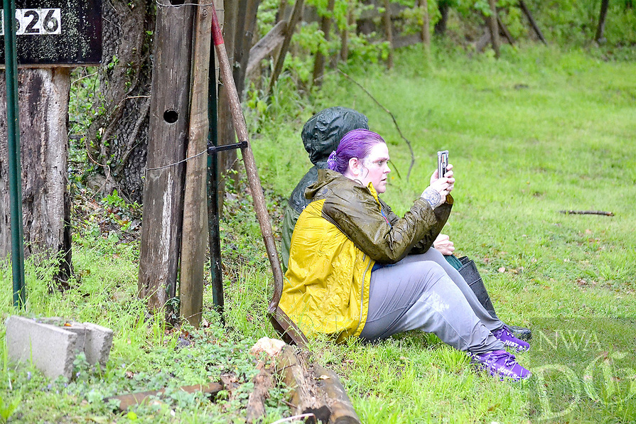 Em Douglass tries to photograph the scene as she watches water rescue personnel try to reach here 21-year-old son, Jaxon, who was stranded in the water at her parents' home off Rustic Drive Wednesday morning.<br />(Pea Ridge Times/Annette Beard)