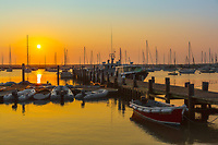 The sun rises over Vineyard Haven Harbor in Tisbury, Massachusetts on Martha's Vineyard.