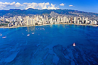 Aerial view of Waikiki Coastline with deep blue ocean in the foreground