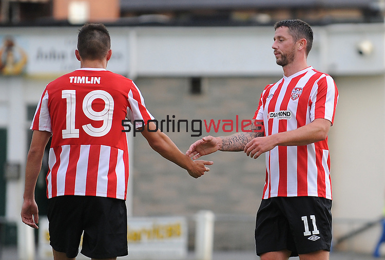 10 July 2014; Rory Patterson, Derry City, celebrates scoring his sides fourth goal with team-mate Mark Timlin, Aberystwyth Town. UEFA Europa League First Qualifying Round, Second Leg, Aberystwyth Town v Derry City. Park Avenue, Aberystwth, Wales. Picture credit: Ian Cook / SPORTINGWALES