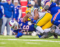 """14 December 2014: Buffalo Bills running back Anthony """"Boobie"""" Dixon is tackled by Green Bay Packers inside linebacker Sam Barrington after a 4-yard gain in the third quarter at Ralph Wilson Stadium in Orchard Park, NY. The Bills defeated the Packers 21-13, snapping the Packers' 5-game winning streak and keeping the Bills' 2014 playoff hopes alive. Mandatory Credit: Ed Wolfstein Photo *** RAW (NEF) Image File Available ***"""