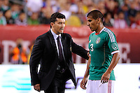 Mexico head coach Jose Manuel de la Torre talks with Carlos Salcido (3). The men's national teams of the United States (USA) and Mexico (MEX) played to a 1-1 tie during an international friendly at Lincoln Financial Field in Philadelphia, PA, on August 10, 2011.