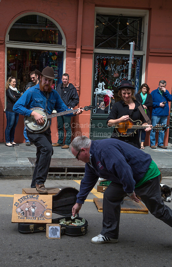 "French Quarter, New Orleans, Louisiana.  Making a Donation to Street Performers, Royal Street.  Tap Dancer and Banjo Player.  ""13 Strings and a Two Dollar Bill."""