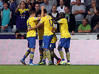 Saturday 28 September 2013<br /> Pictured: Serge Gnabry of Arsenal mobbed by team mates, is celebrating his opening goal.<br /> Re: Barclay's Premier League, Swansea City FC v Arsenal at the Liberty Stadium, south Wales.