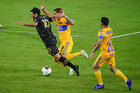 22nd December 2020, Orlando, Florida, USA;  LAFC Carlos Vela is tripped up during the Concacaf Championship between LAFC and Tigres UANL on December 22, 2020, at Exploria Stadium in Orlando, FL.