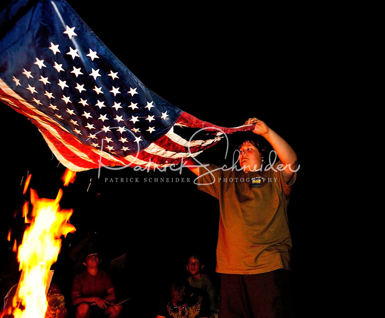 Mecklenburg County Boy Scouts retire an old flag during a campout in Iredell County, North Carolina.