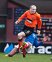Gers Kal Naismith gets a straight red for this challenge on United's Willo Flood.