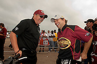 May 1, 2011; Baytown, TX, USA: NHRA top fuel dragster driver Del Worsham (right) celebrates with team owner Alan Johnson after winning the Spring Nationals at Royal Purple Raceway. Mandatory Credit: Mark J. Rebilas-