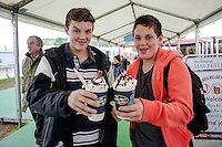 Thursday  29 May 2014, Hay on Wye, UK<br /> Pictured: ( L-R )  Peter and Toby morris from Hampshire tuck in to some Hot chocolate on the Festival site<br /> Re: The Hay Festival, Hay on Wye, Powys, Wales UK.