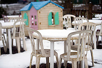 Snow covered furniture at the Ape and Monkey Santuary near Coelbren in the Swansea Valley in South Wales.