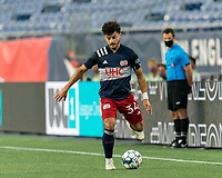 FOXBOROUGH, MA - AUGUST 21: Ryan Spaulding #34 of New England Revolution II passes the ball during a game between Richmond Kickers and New England Revolution II at Gillette Stadium on August 21, 2020 in Foxborough, Massachusetts.