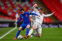 25th March 2021; Wembley Stadium, London, England;  Nanni Nicola San Marino slides in for the ball and tackles Ben Chilwell England 3 during the World Cup 2022 Qualification match between England and San Marino at Wembley Stadium in London, England.