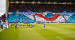 The teams emerge to a welcome from the Rangers fans