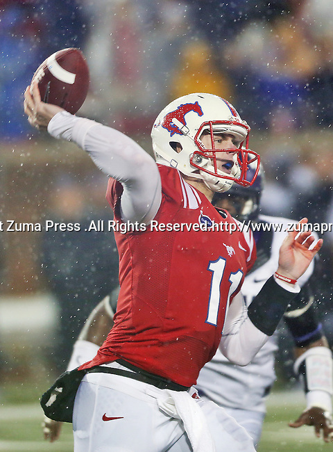 Southern Methodist Mustangs quarterback Garrett Gilbert (11) in action during the game between the Southern Methodist Mustangs and the TCU Horned Frogs at the Gerald J. Ford Stadium in Dallas, Texas. TCU leads SMU 21 to 10 at halftime..