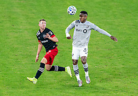WASHINGTON, DC - NOVEMBER 8: Russell Canouse #4 of D.C. United defends Romell Quioto #30 of the Montreal Impact during a game between Montreal Impact and D.C. United at Audi Field on November 8, 2020 in Washington, DC.