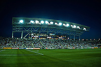 Night MLS game at a sold out soccer stadium