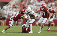 Arkansas linebacker Grant Morgan (31) stops Texas running back Bijan Robinson (5), Saturday, September 11, 2021 during the first quarter of a football game at Reynolds Razorback Stadium in Fayetteville. Check out nwaonline.com/210912Daily/ for today's photo gallery. <br /> (NWA Democrat-Gazette/Charlie Kaijo)