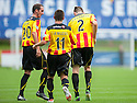 Partick's Mark Kerr looks a bit bemused as Stephen O'Donnell does some Beyonce after he scores their first goal.