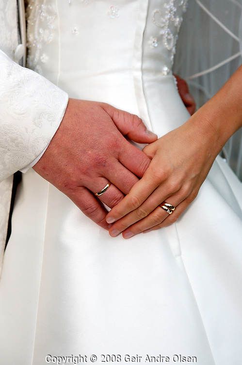 Newly wedd couple showing rings outside of chapple