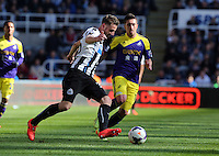 Pictured: Pablo Hernandez of Swansea (R) against Mathieu Debuchy (L) of Newcastle. Saturday 19 April 2014<br /> Re: Barclay's Premier League, Newcastle United v Swansea City FC at St James Park, Newcastle, UK.