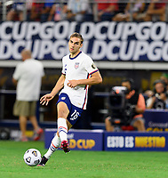 DALLAS, TX - JULY 25: James Sands #16 of the United States passes the ball to a teammate during a game between Jamaica and USMNT at AT&T Stadium on July 25, 2021 in Dallas, Texas.