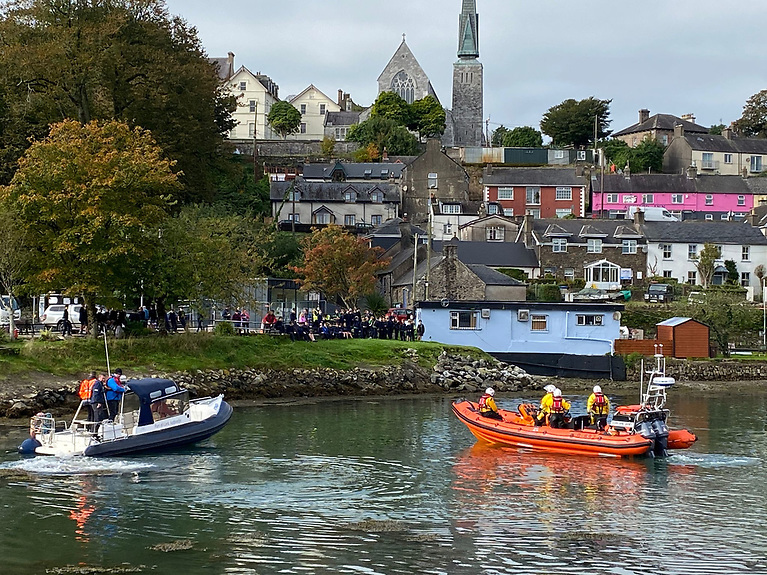 The dolphins were accompanied out of the shallow water by local boats including the RNLI lifeboat in the Crosshaven Harbour, four or five times, as the tide was going out