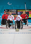 Sochi, RUSSIA - Mar 10 2014 -  Dennis Thiessen looks on as Mark Ideson takes a shot  during Canada vs USA in Wheelchair Curling round robin play at the 2014 Paralympic Winter Games in Sochi, Russia.  (Photo: Matthew Murnaghan/Canadian Paralympic Committee)