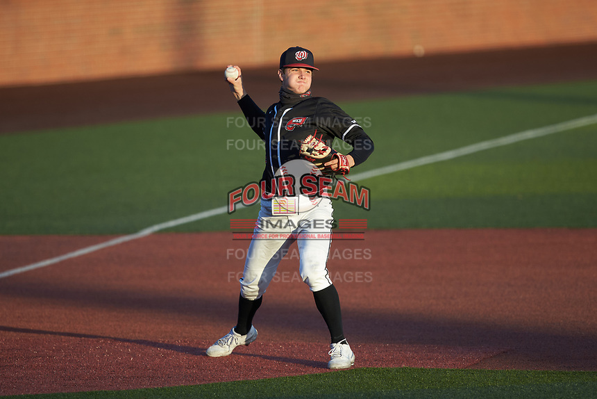 Western Kentucky Hilltoppers third baseman Matthew Meyer (2) makes a throw to first base against the Valparaiso Crusaders at Nick Denes Field on March 19, 2021 in Bowling Green, Kentucky. (Brian Westerholt/Four Seam Images)