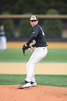 Wake Forest Demon Deacons relief pitcher Connor Johnstone (30) in action against the Appalachian State Mountaineers at Wake Forest Baseball Park on February 13, 2015 in Winston-Salem, North Carolina.  The Mountaineers defeated the Demon Deacons 10-1.  (Brian Westerholt/Four Seam Images)