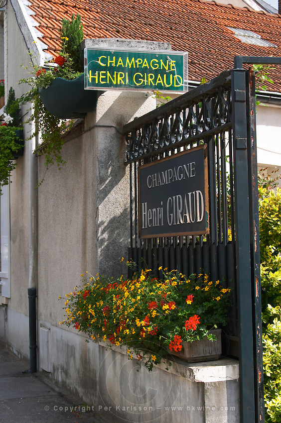In front of the winery, a neon sign and a traditional sign on the gate. Champagne house Maison Giraud-Hemart, also called Champagne Henri Giraud, Ay, Vallée de la Marne, Champagne, Marne, Ardennes, France