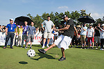 Allen Iverson kicks a football at the 14th hole during the World Celebrity Pro-Am 2016 Mission Hills China Golf Tournament on 22 October 2016, in Haikou, China. Photo by Victor Fraile / Power Sport Images
