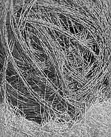 """""""Barbed Wire Ball""""<br /> Skyline Mill Creek Scenic Drive, Kansas<br /> <br /> The Skyline Mill Creek Scenic Drive is one of many roads that offer scenic views of the Flint Hills in northeastern Kansas. This photo shows barbed wire rolled-up into a large ball for easier handling. The wire ball was laying beside the road north of Alta Vista."""