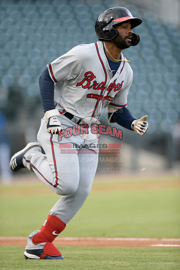 Right fielder Henry Quintero (24) of the Rome Braves runs out a batted ball in a game against the Columbia Fireflies on Tuesday, June 4, 2019, at Segra Park in Columbia, South Carolina. Columbia won, 3-2. (Tom Priddy/Four Seam Images)