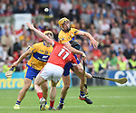 Cian Dillon and Jason Mc Carthy of Clare in action against Conor Lehane of Cork during their Munster senior hurling final at Thurles. Photograph by John Kelly.