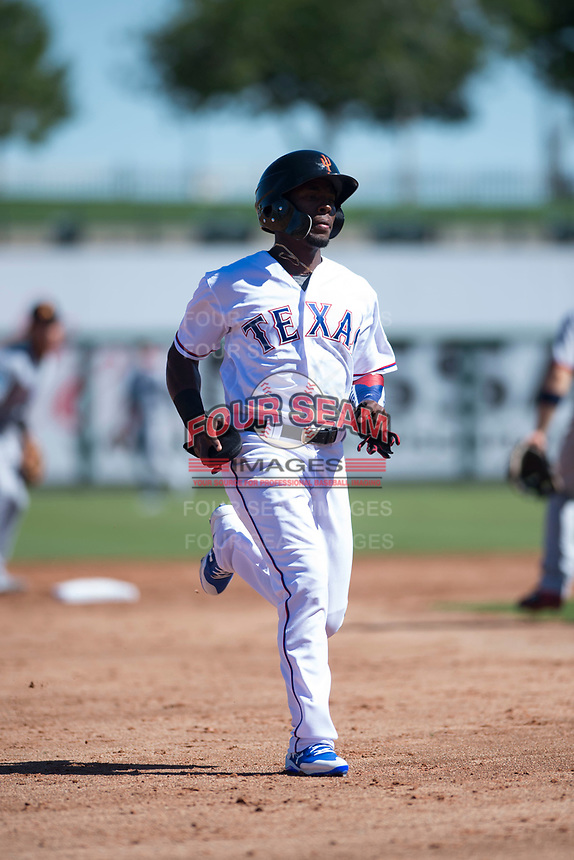 Surprise Saguaros outfielder Julio Pablo Martinez (40), of the Texas Rangers organization, jogs towards third base during an Arizona Fall League game against the Salt River Rafters on October 9, 2018 at Surprise Stadium in Surprise, Arizona. Salt River defeated Surprise 10-8. (Zachary Lucy/Four Seam Images)