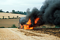 Tractor and round hay baler explodes into flames in the middle of a field..©shoutpictures.com..john@shoutpictures.com