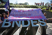 "Members of the Women's Worldwide March unfurl a banner ""The BNDES Finances Sexual Exploitation of Women"" outside the offices of BNDES after marching from the People's Summit at the United Nations Conference on Sustainable Development (Rio+20), Rio de Janeiro, Brazil, 18th June 2012."