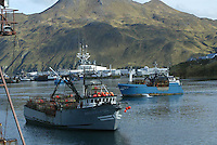 10/12/03 crab NWS::  The F/V Arctic Fox and F/V Vixen sits move around in Margaret's Bay in the Port of Dutch Harbor, Alaska.