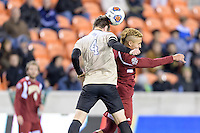Houston, TX - Friday December 9, 2016: Kevin Politz (4) of the Wake Forest Demon Deacons wins a header over Andre Shinyashiki (9) of the Denver Pioneers at the NCAA Men's Soccer Semifinals at BBVA Compass Stadium in Houston Texas.