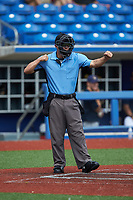 Home plate umpire Caleb Stone calls a batter out on strikes during game five of the South Atlantic Border Battle at Truist Point on September 27, 2020 in High Pont, NC. (Brian Westerholt/Four Seam Images)